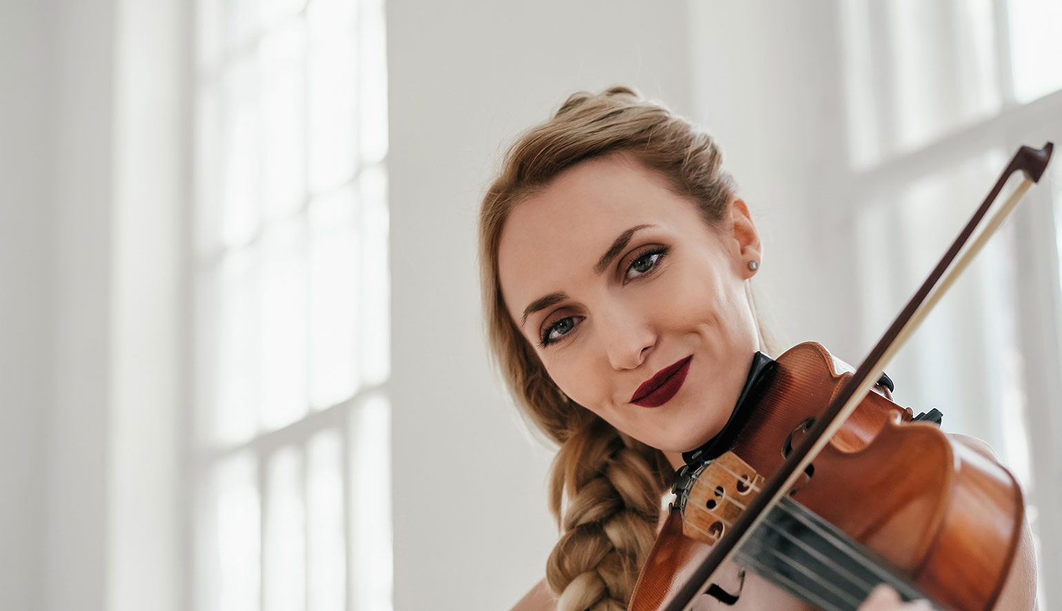 The prefect violin being played by a beautiful confident women